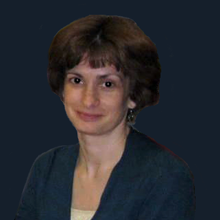 photo of Linda Budinski at registration desk