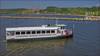 Photo of the National Harbor Water Taxi in daylight.
